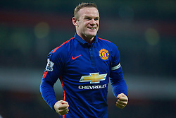 LONDON, ENGLAND - Saturday, November 22, 2014: Manchester United's Wayne Rooney celebrates the Arsenal own goal during the Premier League match at the Emirates Stadium. (Pic by David Rawcliffe/Propaganda)