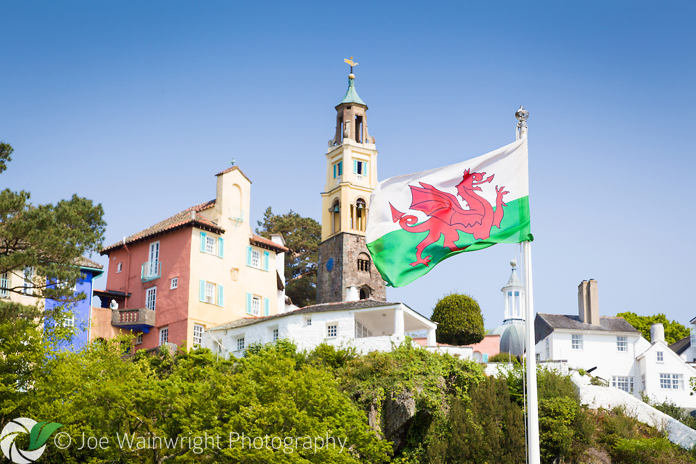 The flag of Wales flies at Portmeirion, Gwynedd, North Wales, with the Campanile in the background.