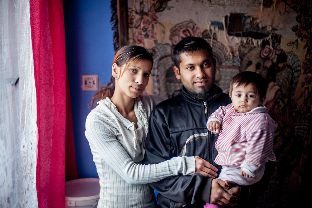 Michal, 22 years old father and his wife Valeria (18) with their one year old daughter Olivia in the new built house. Michal has finished a two-year study program as a bricklayer and it is very difficult to find regular work in the region. Michal and his family joined a micro loan project with the support of foundation ETP Slovakia which is working in Rankovce and setting up micro-loan funds for the local Roma community. family member and a study desk for children's homework.