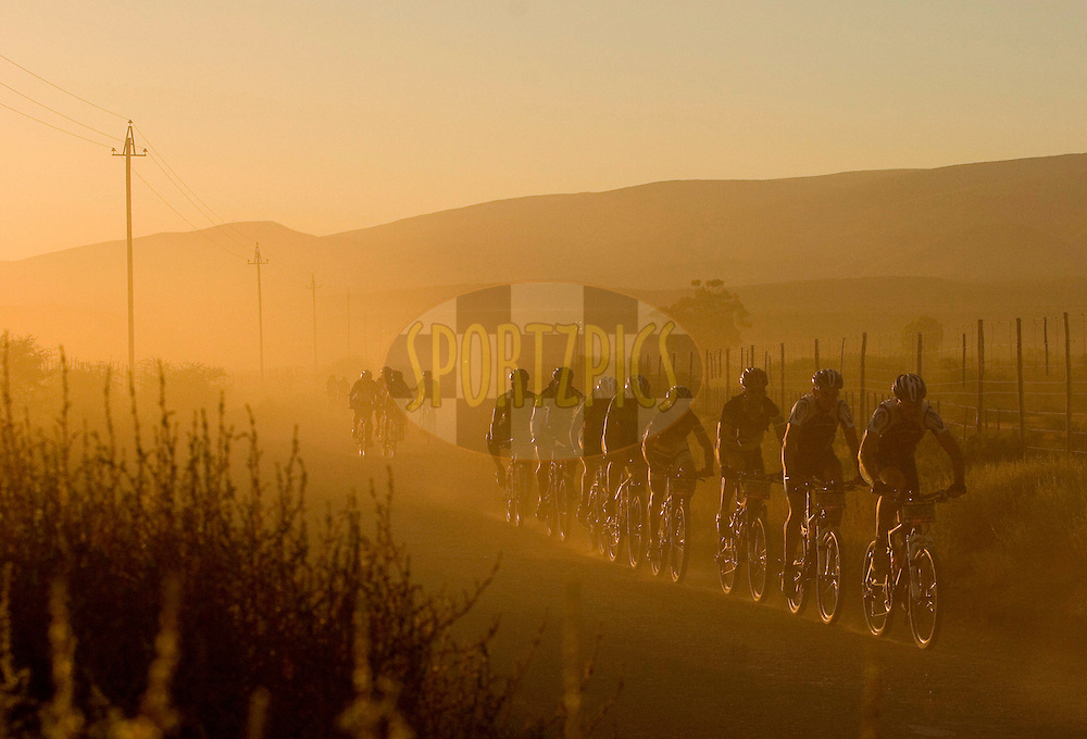 WESTERN CAPE, SOUTH AFRICA -  31 March 2008, Sunrise during stage three of the 2008 Absa Cape Epic Mountain Bike stage race from Calitzdorp Spa.to Langenhoven High School in Riversdale, Western Cape, South Africa..Photo by Karin Schermbrucker/SPORTZPICS