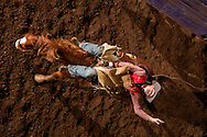 Wesley Cole, from Oklahoma Panhandle State University, leans back on a bronco to distribute his weight while riding during the bareback finals of Sundays KSU Rodeo held at Weber Arena on February 22, 2015.