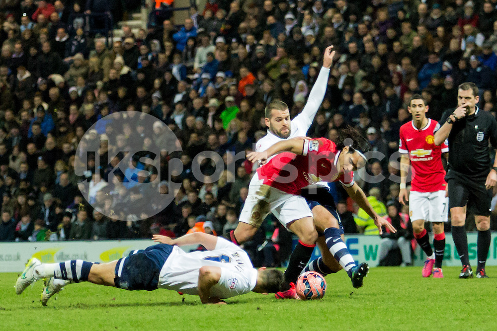 Manchesrter United's Radamel Falcao tries to get past Preston's Bailey Wright (on the floor) and Josh Welsh (tackling) during the The FA Cup match between Preston North End and Manchester United at Deepdale, Preston, England on 16 February 2015. Photo by James Williamson.