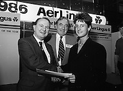 10/01/1986.01/10/1986.10th January 1986.The Aer Lingus Young Scientist of the Year Exhibition at the RDS, Dublin...Picture shows Con Power, (left) Director, Economic Policy, Confederation of Irish Industries presenting the CII Award for the Physical, Mathematical and Applied Sciences, Senior Pupils to Colman Byrnes, of the Methodist College, Belfast. Also pictured is Niall G. Weldon, Chairman of the Panel of Judges. Colman's winning project was entitled 'The Eight Directional Joystick'. .