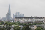 London, England, UK, May 31 2018 -  Aylesbury Estate,  a housing estate in Walworth, South East London, pictured  with The Shard and the City's skyscrapers in the background. <br /> Aylesbury  estate, once the largest estate in Europe, is currently undergoing a major regeneration programme by demolishing and replacing of the dwellings with modern houses controlled by a housing association. Some residents and activists still protest against the demolition and the gentrification of London.<br /> London is facing a major housing crisis, due to rising cost and under-supply.