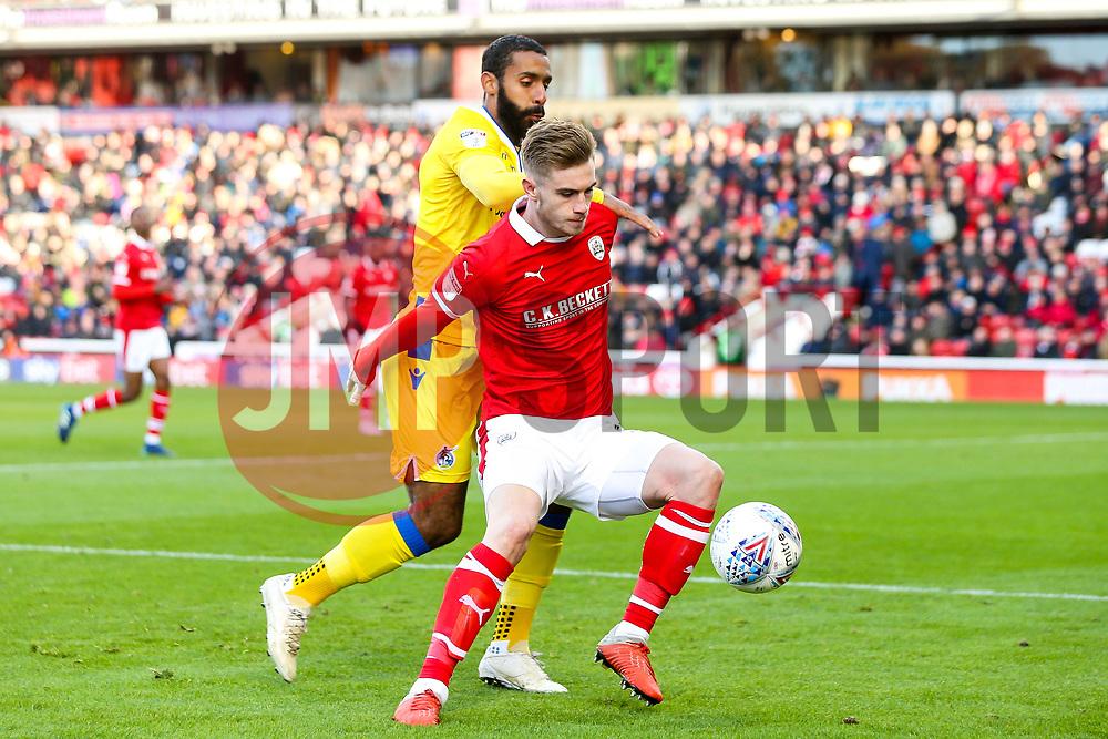 Liam Lindsay of Barnsley takes on Stefan Payne of Bristol Rovers - Mandatory by-line: Robbie Stephenson/JMP - 27/10/2018 - FOOTBALL - Oakwell Stadium - Barnsley, England - Barnsley v Bristol Rovers - Sky Bet League One