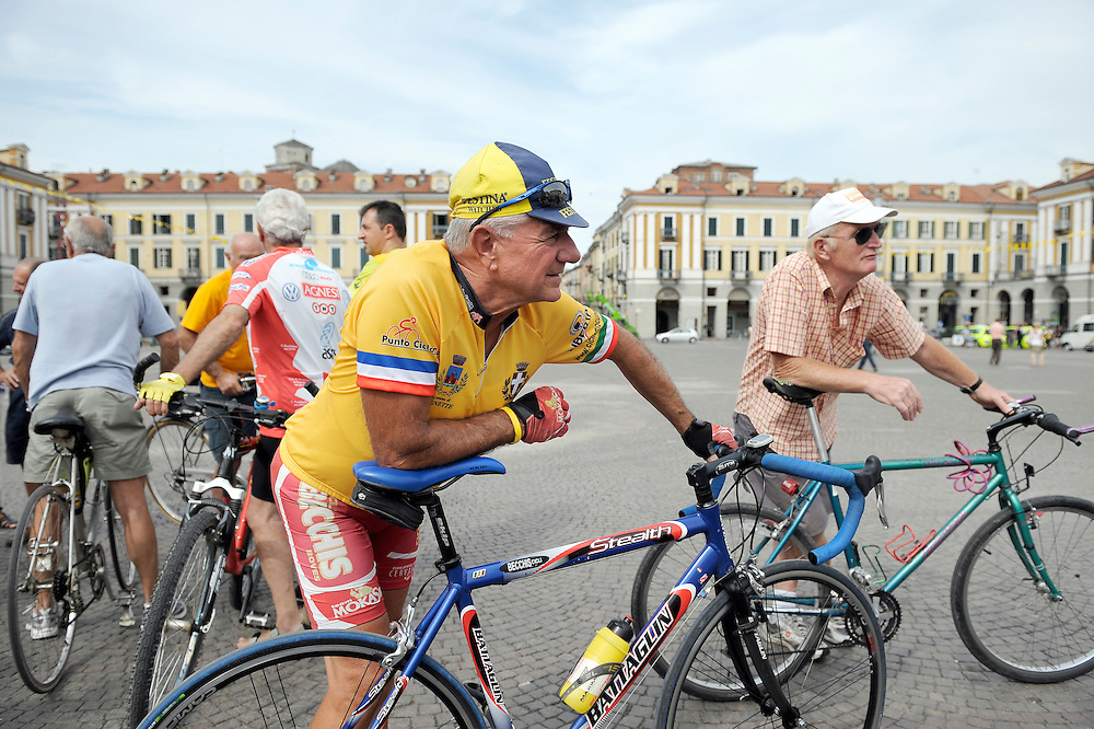 Cuneo, Italy. 16th stage: Piazza Galimberti in Cuneo, is the meeting point of all cycling fans, one day before the departure of the 16th stage. The Tour de France is a bicycle race over more than 3,500 kilometers. It is held in France and visits a bordering country every year. It usually lasts 23 days. The race is broken down into day-long segments, called stages. Individual times to finish each stage are totaled to determine the overall winner for the race. The rider with the least elapsed time each day wears a yellow jersey. The course changes every year but it has always finished in Paris. There are similar races in Italy and Spain but the Tour de France is the oldest, the most prestigious and the best known.
