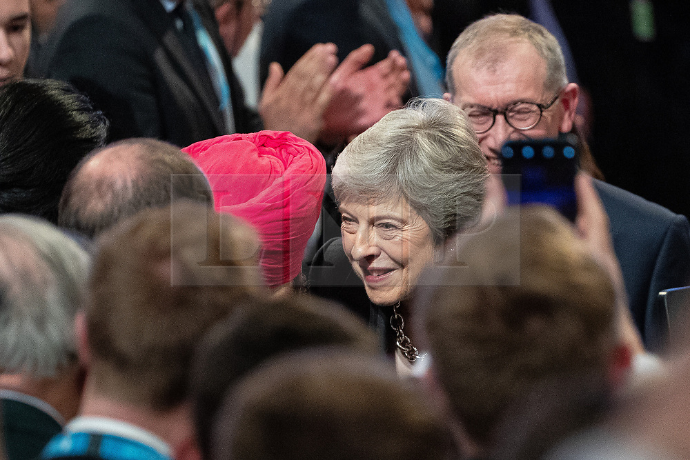 © Licensed to London News Pictures . 03/10/2018. Birmingham, UK. Prime Minister THERESA MAY leaves the conference through the audience after delivering the Leader's Speech . Day 4 of the Conservative Party conference at the ICC in Birmingham . Photo credit: Joel Goodman/LNP