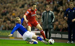 LIVERPOOL, ENGLAND - Tuesday, March 13, 2012: Liverpool's Stewart Downing in action against Everton's Tony Hibbert during the Premiership match at Anfield. (Pic by David Rawcliffe/Propaganda)