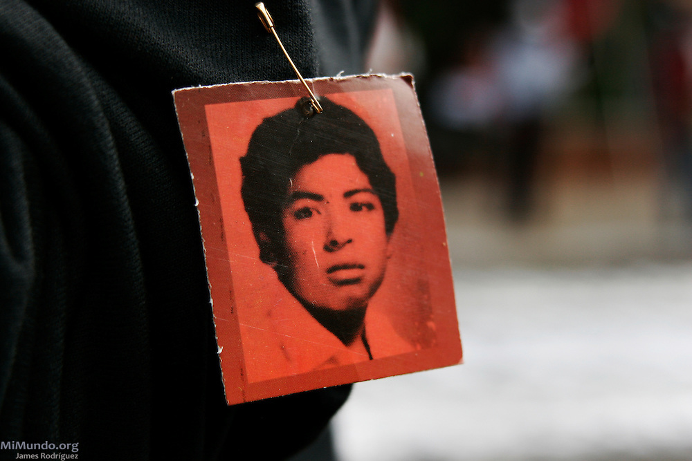 A participant in the March for Remembrance displays a makeshift pin with the portrait of Herbert Carias Solares, one of Guatemala's 45,000 forced disappearance victims. Organized by H.I.J.O.S. (Sons and Daughters for Identity and Justice Against Forgetfulness and Silence), the March for Remembrance is a counter march to the annual Military Day parade, seen by many as inadequate in modern Guatemala considering the atrocities carried out by the institution against the local population during the 36-year internal armed conflict. Guatemala City, Guatemala. June 30, 2007.