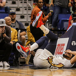 Mar 27, 2018; New Orleans, LA, USA; New Orleans Pelicans forward Anthony Davis (23) grabs his ankle following a fall during the fourth quarter at the Smoothie King Center. Davis would exit the game briefly but continued to limp throughout the remainder of the game. The Trail Blazers defeated the Pelicans 107-103. Mandatory Credit: Derick E. Hingle-USA TODAY Sports