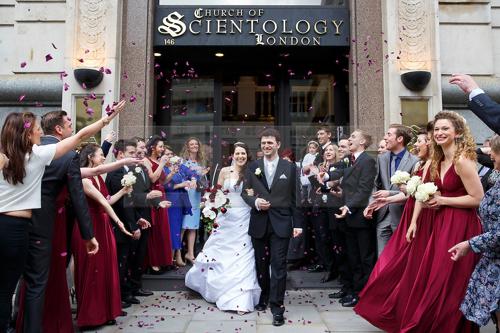 © licensed to London News Pictures. London, UK 23/02/2014. Louisa Hodkin (maiden name) and Alessandro Calcioli leaving the Church of Scientology chapel in central London after the first scientology wedding in Britain. The couple won a Supreme Court challenge to be the first ones to marry at a Church of Scientology chapel. Photo credit: Tolga Akmen/LNP