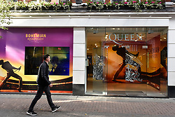 "© Licensed to London News Pictures. 18/10/2018. LONDON, UK.  Exterionr views of the Queen pop-up shop which has opened in Carnaby Street.  Coinciding with the release next week of the movie ""Bohemian Rhapsody"", the shop offers Queen music fans memorabilia, a display of stage costumes as well as archived Queen performance footage.  Photo credit: Stephen Chung/LNP"