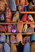 MOROCCO: Marrakesh<br /> Handmade leather slippers for sale in the bazar come in all shades and designs.