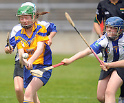 Siofra Ryan St Cillian's (Offaly) faile to block Karen Gallagher Sixmilebridge in the Division 2 Camoige  Final at Pearse Stadium in the Féile na nGael 2011. Photo:Andrew Downes.
