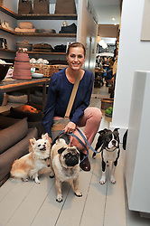 YASMIN LE BON and her pet dogs at a party at Mungo & Maud, 79 Elizabeth Street, London to celebrate the launch of a collection of dog accessories designed by Yasmin Le Bon held on 22nd November 2011.