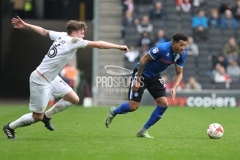 Nathaniel Mendez-Laing (11) outpaces Robbie Muirhead (16) during the EFL Sky Bet League 1 match between Milton Keynes Dons and Rochdale at stadium:mk, Milton Keynes, England on 11 March 2017. Photo by Daniel Youngs.