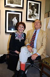 The EARL OF SNOWDON and MARJORIE WALLACE at an exhibition of photographs by Lord Snowdon held at the Chris Beetles Gallery, Ryder Street, London on 18th September 2006.<br />