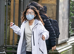 © Licensed to London News Pictures. 31/01/2020. Manchester , UK . A  woman wears a protective mask as they walk  in Central Manchester. Two people in the same family have been diagnosed with the Coronavirus in the UK, which has killed at least 213 people in China Photo credit: Ioannis Alexopoulos /  LNP