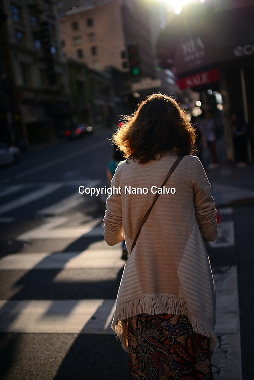 Woman in crosswalk, San Francisco.