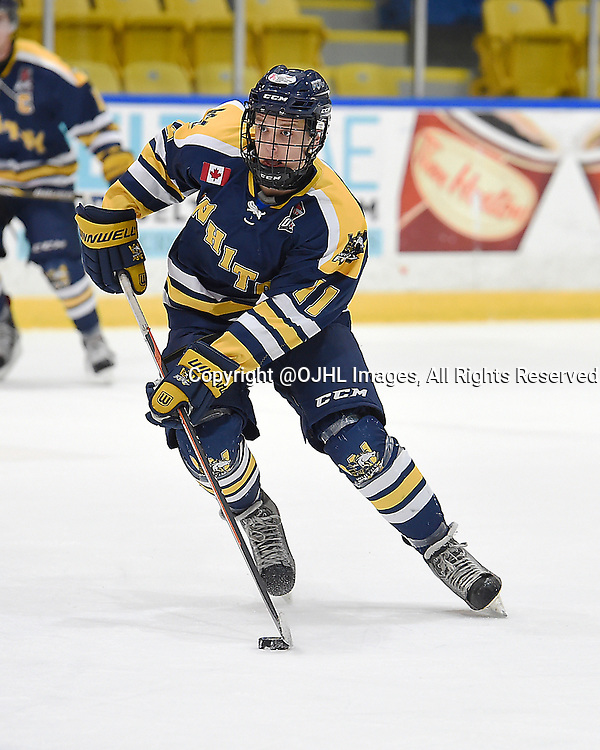 WHITBY, ON - Oct 9, 2015 : Ontario Junior Hockey League game action between Newmarket and Whitby, Justin Allen #11 of the Whitby Fury skates with the puck during the first period.<br /> (Photo by Andy Corneau / OJHL Images)