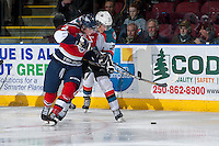 KELOWNA, CANADA -FEBRUARY 19: Justin Kirkland #23 of the Kelowna Rockets checks Devon McAndrews #32 of the Tri City Americans during third period on February 19, 2014 at Prospera Place in Kelowna, British Columbia, Canada.   (Photo by Marissa Baecker/Getty Images)  *** Local Caption *** Justin Kirkland; Devon McAndrews;