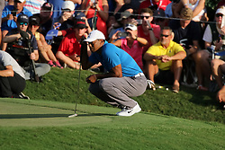 September 22, 2018 - Atlanta, GA, U.S. - ATLANTA, GA - SEPTEMBER 22:     Tiger Woods lines up his putt on the 18th green during the third round of the Tour Championship on September 22, 2018, at East  Lake Golf Club in Atlanta, GA.  (Photo by Michael Wade/Icon Sportswire) (Credit Image: © Michael Wade/Icon SMI via ZUMA Press)