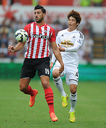 Southampton's Graziano Pelle controls the ball. - Photo mandatory by-line: Alex James/JMP - Mobile: 07966 386802 20/09/2014 - SPORT - FOOTBALL - Swansea - Liberty Stadium - Swansea City v Southampton  - Barclays Premier League