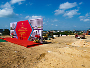 "14 FEBRUARY 2019 - SIHANOUKVILLE, CAMBODIA:  The site of the groundbreaking for the Trimulia Tower, a joint Chinese-Malaysian mixed use development in Sihanoukville. The tower will be a few kilometers from central Sihanoukville. The developers said skyrocketting land prices in Sihanoukville forced them to select land further from downtown. There are about 80 Chinese casinos and resort hotels open in Sihanoukville and dozens more under construction. The casinos are changing the city, once a sleepy port on Southeast Asia's ""backpacker trail"" into a booming city. The change is coming with a cost though. Many Cambodian residents of Sihanoukville  have lost their homes to make way for the casinos and the jobs are going to Chinese workers, brought in to build casinos and work in the casinos.      PHOTO BY JACK KURTZ"