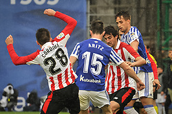 April 28, 2018 - San Sebastian, Spain - Cordoba and San Jose of Athletic Club  duels for the ball with Aritz Elustondo amd Adnan Januzaj of Real Sociedad during the Spanish league football match between Real Sociedad and AtHletic Club Bilbao at the Anoeta Stadium on 28 April 2018 in San Sebastian, Spain  (Credit Image: © Jose Ignacio Unanue/NurPhoto via ZUMA Press)