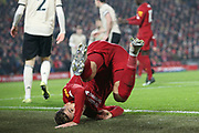 Liverpool forward Roberto Firmino (9) still manages to get the cross in before ending up upside down during the Premier League match between Liverpool and Manchester United at Anfield, Liverpool, England on 19 January 2020.