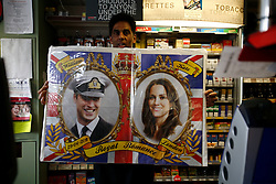 UK ENGLAND BERKSHIRE UPPER BUCKLEBURY 22MAR11 - Hash Shingadia (52) proudly displays a poster of Kate Middleton and Prince William at his Spar store in Upper Bucklebury, Berkshire, England. He took over the village's Peaches Store 13 years ago and is the proud recipient of an invite to the Royal Wedding of Kate Middleton and Prince William...jre/Photo by Jiri Rezac..© Jiri Rezac 2011