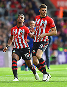 Mario Lemina (18) of Southampton and Wesley Hoedt (6) of Southampton during the Premier League match between Southampton and Chelsea at the St Mary's Stadium, Southampton, England on 7 October 2018.