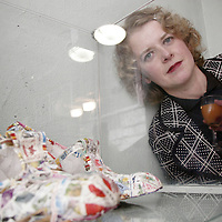 Fiona O'Dwyer just loves her creations called 'shoes to collect the cheque in' as they were on display at the opening night of the Hidden Depths art exhibition in Ennistymon on Wednesday night.<br /> <br /> Photograph by Yvonne Vaughan.