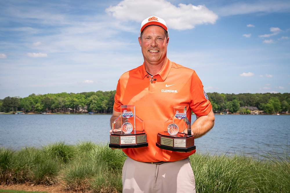 Former Clemson punter and current assistant football coach Bill Spiers poses for as photo after winning the Longest Drive and Closest to the Pin Skills Competition, celebrity division, at the 2019 Chick-fil-A Peach Bowl Challenge at the Ritz Carlton Reynolds, Lake Oconee, on Tuesday, April 30, 2019, in Greensboro, GA. (Paul Abell via Abell Images for Chick-fil-A Peach Bowl Challenge)