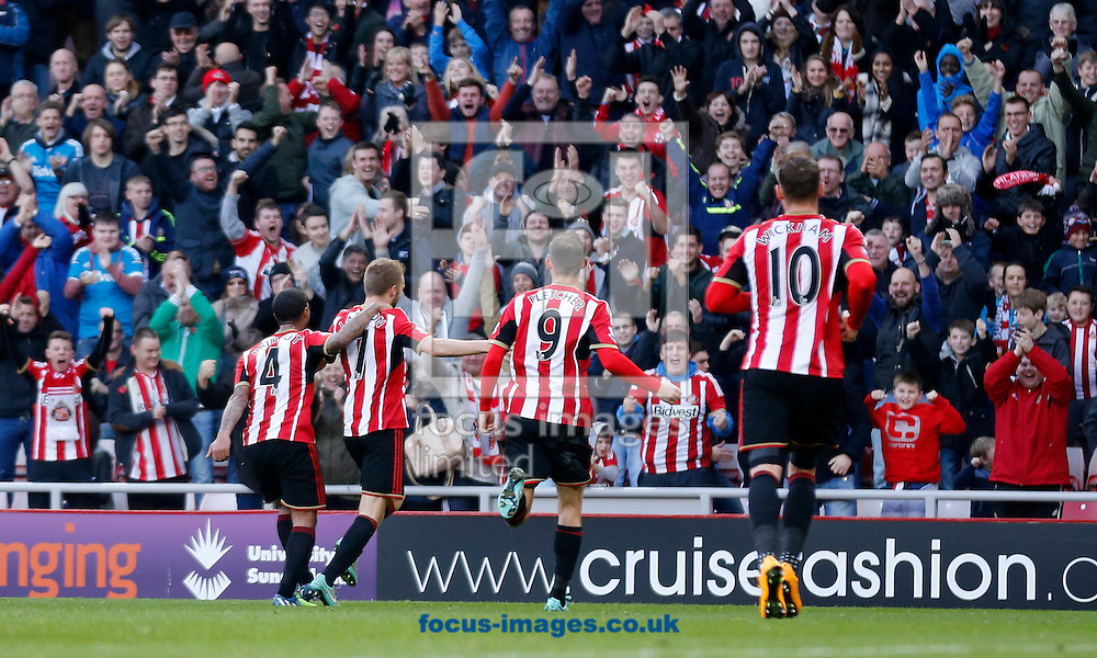 Sebastian Larsson (second left) of Sunderland celebrates scoring the opening goal during the Barclays Premier League match at the Stadium Of Light, Sunderland<br /> Picture by Simon Moore/Focus Images Ltd 07807 671782<br /> 09/11/2014