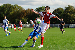 George Kellow of Bristol City U18 is challenged by Jordan Drew of Brighton U18 - Photo mandatory by-line: Rogan Thomson/JMP - Tel: 07966 386802 - 05/10/2013 - SPORT - FOOTBALL - SGS Wise Campus, Bristol - Bristol City U18 v Brighton & Hove Albion U18 - U18 Professional Development League 2.