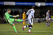 Forest Green Rovers Forward, Christian Doidge (9) closes down Sutton United Goalkeeper, Will Puddy (26) during the Vanarama National League match between Sutton United and Forest Green Rovers at Gander Green Lane, Sutton, United Kingdom on 14 March 2017. Photo by Adam Rivers.