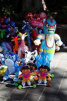 A street vendor's inflatable wares in the Zocalo, Oaxaca, Mexico.