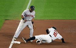 September 19, 2017 - Baltimore, MD, USA - The Baltimore Orioles' Adam Jones (10) slides into third base in front of Boston Red Sox third baseman Rafael Devers for a stolen base in the sixth inning at Oriole Park at Camden Yards in Baltimore on Tuesday, Sept. 19, 2017. The Red Sox won, 1-0, in 11 innings. (Credit Image: © Kenneth K. Lam/TNS via ZUMA Wire)