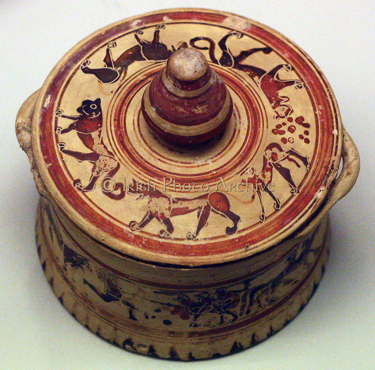 Greek cosmetic box, or 'pyxis' depicting Heracles fighting triple-bodied monster Geryon. Protocorinthian, made circa 680-650 BC in Corinth. From Phaleron, near Athens.