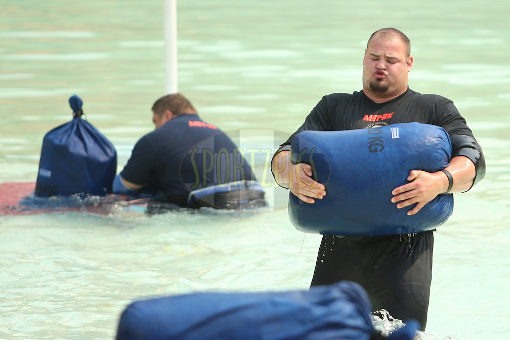 Brian Shaw (USA) takes the lead over defending champion Zydrunas Savickas (Lithuania) in the sand sack race in the pool at the Valley of the Waves during the final rounds of the World's Strongest Man competition held in Sun City, South Africa.