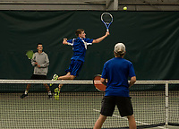 Connor Craigie jumps for a shot during doubles match with his partner Grant Workman against Kearsarge Tyler and Tucker Valovic during NHIAA semi final Division III tennis at Gilford Hills Club on Friday afternoon.  (Karen Bobotas/for the Laconia Daily Sun)