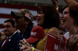 People in the audience react to Republican presidential nominee Donald Trump as he delivers a speech at a rally in Aston, Pennsylvania.