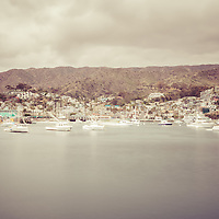 Catalina Island Avalon Bay retro photo with boats, mountains, and hillside buildings