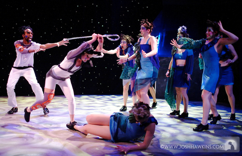 """Chicago Tap Theatre's production """"Changes"""" - A science fiction tap dance opera featuring the music of David Bowie at Stage 773 in Chicago...Stacy Milam as """"Provo"""" with Phil Brooks as """"Ug"""" and """"The Alliance"""" in the background"""