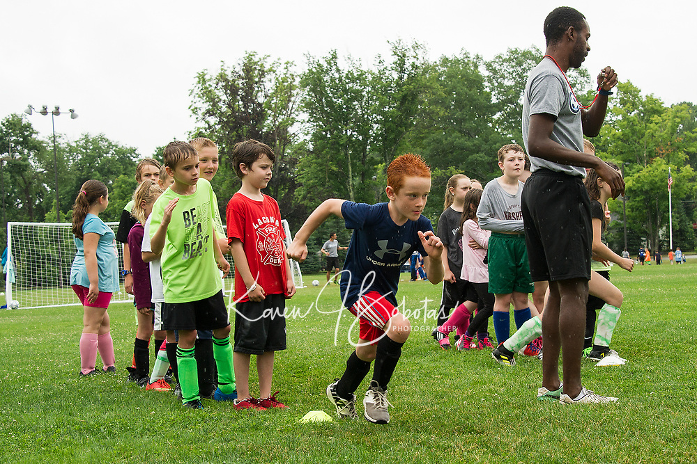 Coach Jonathan works through drills with the Division II athletes during On Goal Soccer Camp at Leavitt Park on Thursday morning.  (Karen Bobotas/for the Laconia Daily Sun)