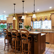 CHERRY HILL, NJ - DECEMBER 23, 2016: The open kitchen on the first floor has tile flooring, a double oven, custom refrigerator, granite counters and a breakfast nook. Access to the back yard by the breakfast nook. 9 Gwen Court, Cherry Hill, NJ. Credit: Albert Yee for the New York Times