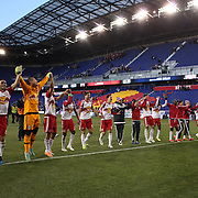 New York Red Bulls players celebrate with fans at the end of the game after their 2-0 victory during the New York Red Bulls Vs D.C. United, Major League Soccer regular season opening match at Red Bull Arena, Harrison, New Jersey. USA. 22nd March 2015. Photo Tim Clayton