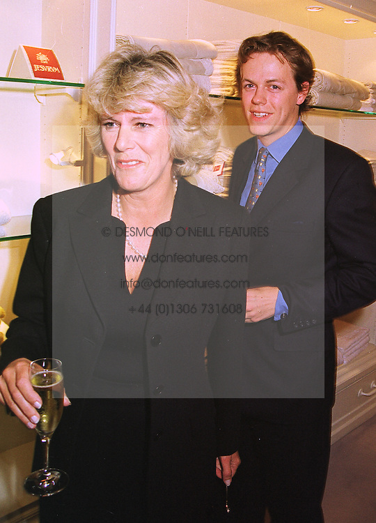 MR TOM PARKER BOWLES and his mother MRS CAMILLA PARKER BOWLES, at a party in London on 13th October 1998.MKT 76