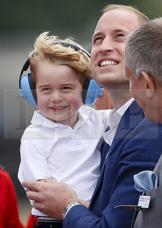 ©  London News Pictures. 08/07/2016. RAF Fairford, UK. Prince WILLIAM and Prince GEORGE during a visit to the International Air Tattoo at RAF Fairford in Gloucestershire where Prince George was introduced to the Red Arrows.  Photo credit: Ian Schofield/LNP